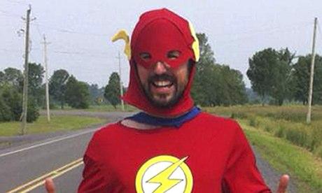 Jamie McDonald in red and white superhero costume