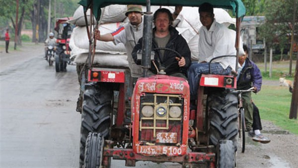 Charley Boorman driving a tractor in Nepal on his By Any Means travels from Ireland to Australia