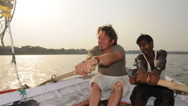 Charley Boorman rowing down the Ganges in his By Any Means trip to Australia