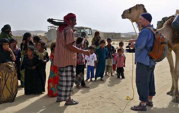 Mikael with camel in Yemen