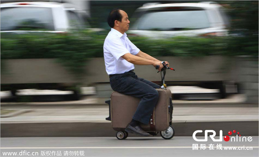 The drivable suitcase scooter on the road
