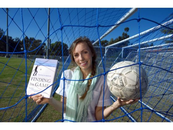 Gwendolyn Oxenham with book n ball