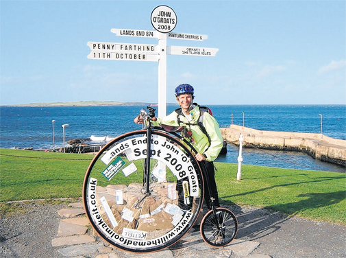 stuart kettell on a penny farthing from Lands End to John O'Groats