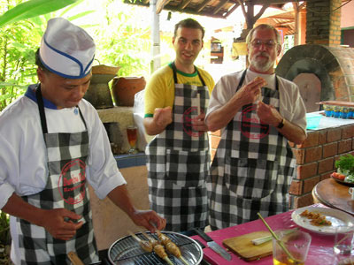 Bill learning to make sate in a Balinese cooking class