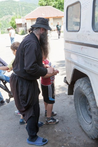 A monk siging the Volvo (Small)