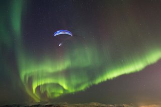 paragliding-in-the-aurora-borealis-in-tromso-norway 1
