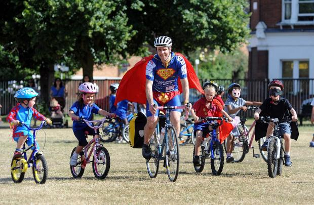 supercyclingman - make the world a better place by getting kids on bikes (1)