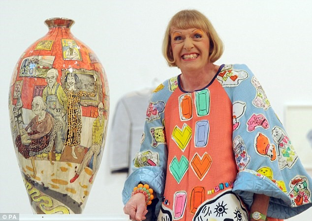 Grayson Perry crossdressed as his alterego Claire with one of his trademark Vase art pieces