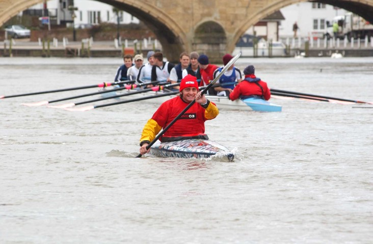 Tim Fitzhigham paddling his paper boat down the River Thames