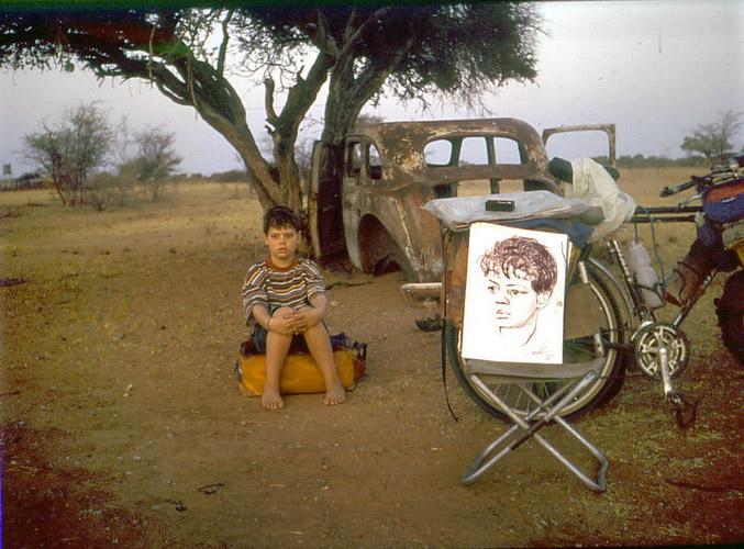 Vladislav Ketov doing a portrait painting job on the road to make some money