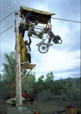 Vladislav Ketov cycling the edge of earth (zip line river transport)